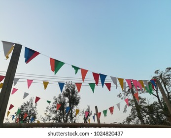 Colorful long flag on high bambooblue.There is a blue sky in the background