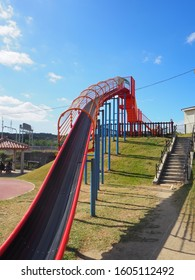 A colorful long slide in the park