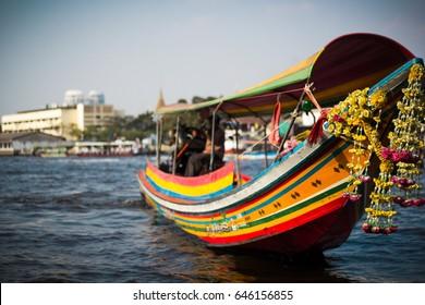 Colorful long-tail boat on the Chaopraya river. Bangkok. Thailand.