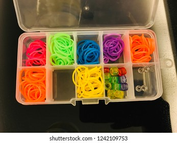 Colorful loom band / Rainbow Loom is a plastic tool used to weave colorful rubber and plastic bands into decorative items such as bracelets and charms.