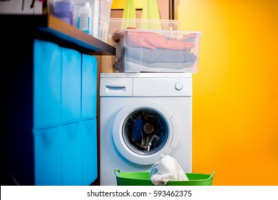 Colorful loundry with washing machine at home