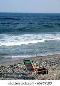 Colorful Lounge Chair on Rocky Beach