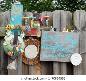 Colorful LOVE THY NEIGHBOR collage erected on neighborhood fence. Also added a free supply of dog poop bags.