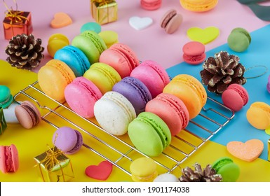 Colorful macarons dessert with vintage pastel tones. Colorful French macarons background, Different colorful macaroon background. Tasty sweet color macaron