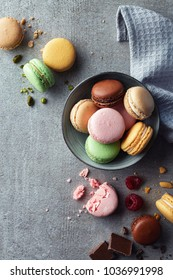 Colorful macarons on gray marble background. Top view. Pastel colors