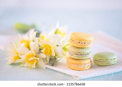 colorful macarons on towel with nice yellow flowers