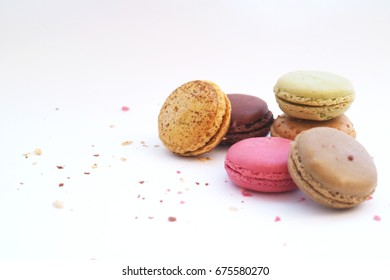 Colorful macarons on the white background, french pastry dessert