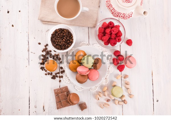 colorful-macarons-on-wooden-table-600w-1