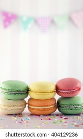 Colorful macarons with pink pastel background