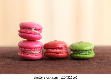 Colorful Macaroon on wooden table and background.