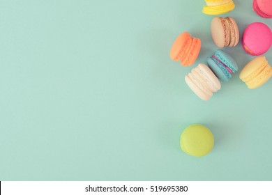 colorful macaroons on blue background,top view vintage color style