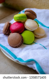 Colorful macaroons on a kitchen towel. Sweet macarons.