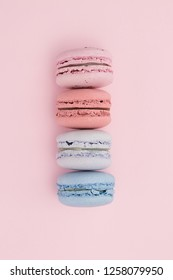Colorful macaroons on the pastel pink background. Holiday concept. Place for text.