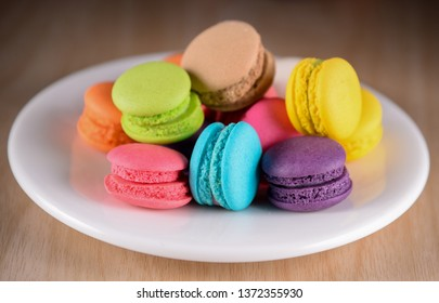 Colorful macaroons. Sweet macarons on dark background