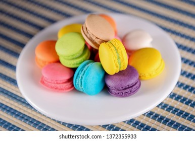 Colorful macaroons. Sweet macarons on background