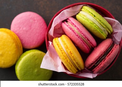 Colorful macaroons. Sweet macarons on retro dark background with copy space. Top view, Holiday time concept