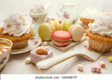Colorful macaroons and sweets, coffe with  marshmallow over white. Winter and Christmas food background