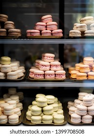 Colorful Macaroons. tasty French macaroon in the shop window. Dessert at pastry confectionary shop. Summer sweets
