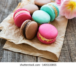 Colorful macaroons and tulips on a old wooden  background