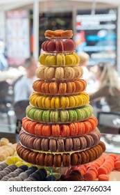 Colorful macaroons in the window of a confectionery