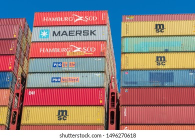 Colorful Maersk, MSC, Hamburg Sud and other shipping containers stacked at container ship facility during day time under blue sky - Oakland, California, USA - August 30, 2019