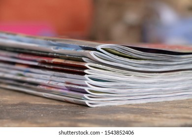 Colorful magazines on wooden table