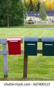 Colorful mailboxes in countryside. Front view, vertical photo.