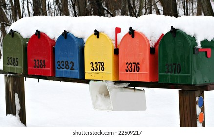 Colorful mailboxes covered in snow