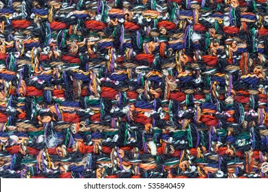 Colorful (main color red and blue) hand weaving matting tweed fabric texture. Closeup horizontal fragment