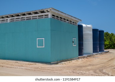 A colorful maintenance building with water tanks on Princess Cays in the Bahamas.