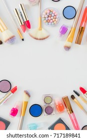 Colorful make up and brushes flat lay scene with copy space