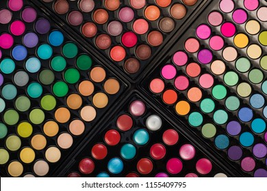 Colorful make-up background. Top view of make-up eyeshadow palettes