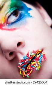 Colorful make-up with candy on her lips