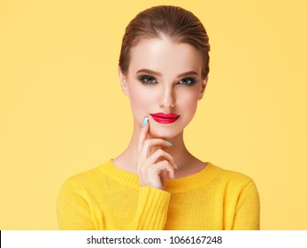 Colorful makeup woman in yellow clothes on color happy summer fashion background