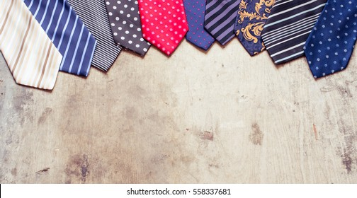 Colorful man ties on a wooden background/toned photo