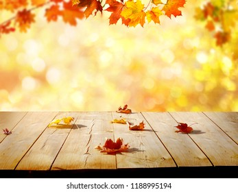 Colorful maple leaves on wooden  table.Falling leaves natural background .Autumn season concepte