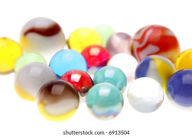 Colorful marbles over white