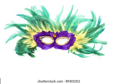 Colorful Mardi Gras mask of feathers isolated on white