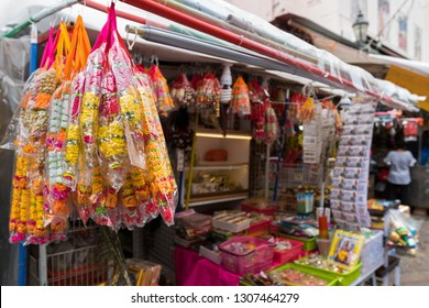 Colorful Marigold flower garlands, other offerings to offer to God during worship at little India, Singapore