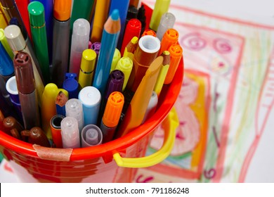 Colorful markers with color pencils and drawings. School material. Horizontal