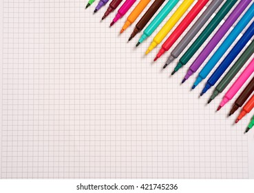 Colorful markers on notebook. Painting with crayons and markers.
