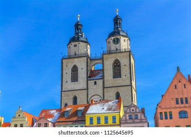 Colorful Market Square Saint Mary's City Church Stadtkirche Lutherstadt Wittenberg Germany. Martin Luther's church. Founded in 1187, restored in 1900s.