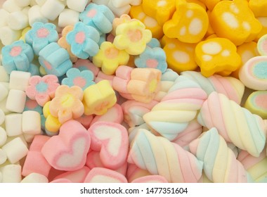 Colorful marshmallow candies assortment as background
