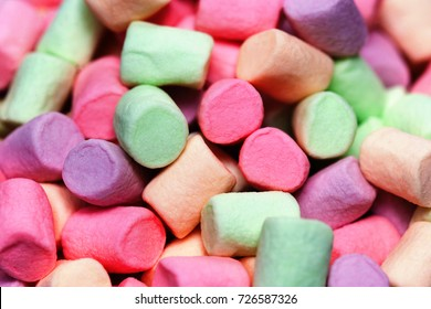 Colorful marshmallows as  background, macro. Fluffy marshmallows texture  or  pattern, close up.