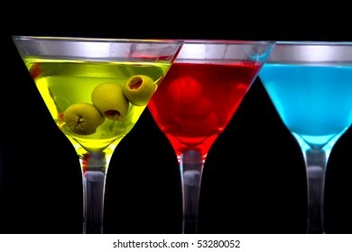 Colorful martini cocktail drinks in glasses