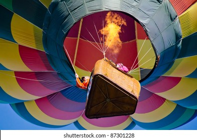 Colorful mass hot air balloons colliding in the air