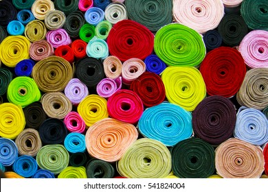 Colorful material fabric rolls - texture samples in the market