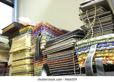 Colorful material swatches and samples for carpeting as used by interior decorators (shallow Depth of Field ? focus on central stack)