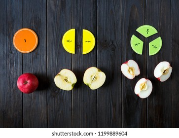 colorful math fractions on brown wooden background or table. interesting math for kids. Education, back to school concept. Geometry and mathematics materials.