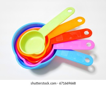 Colorful measuring spoon on white background
